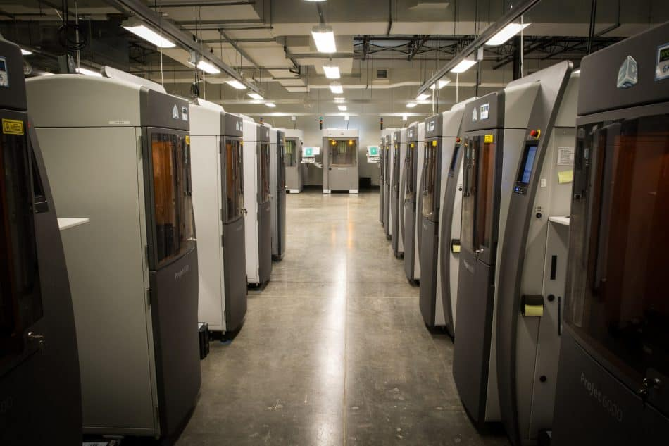 A row of stereolithography (SLA) 3D printers